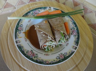 serving-a-plate-of-Oriental-Chicken-Wraps