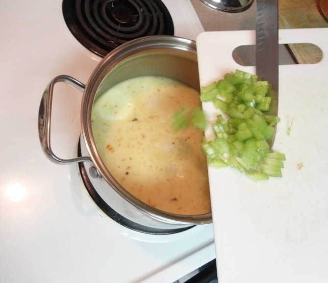 adding diced celery to soup
