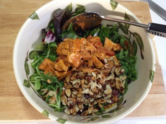 Mixing-the-coated-chicken-toasted-almonds-with-the-greens-to-make-Spanish-Chicken-Salad