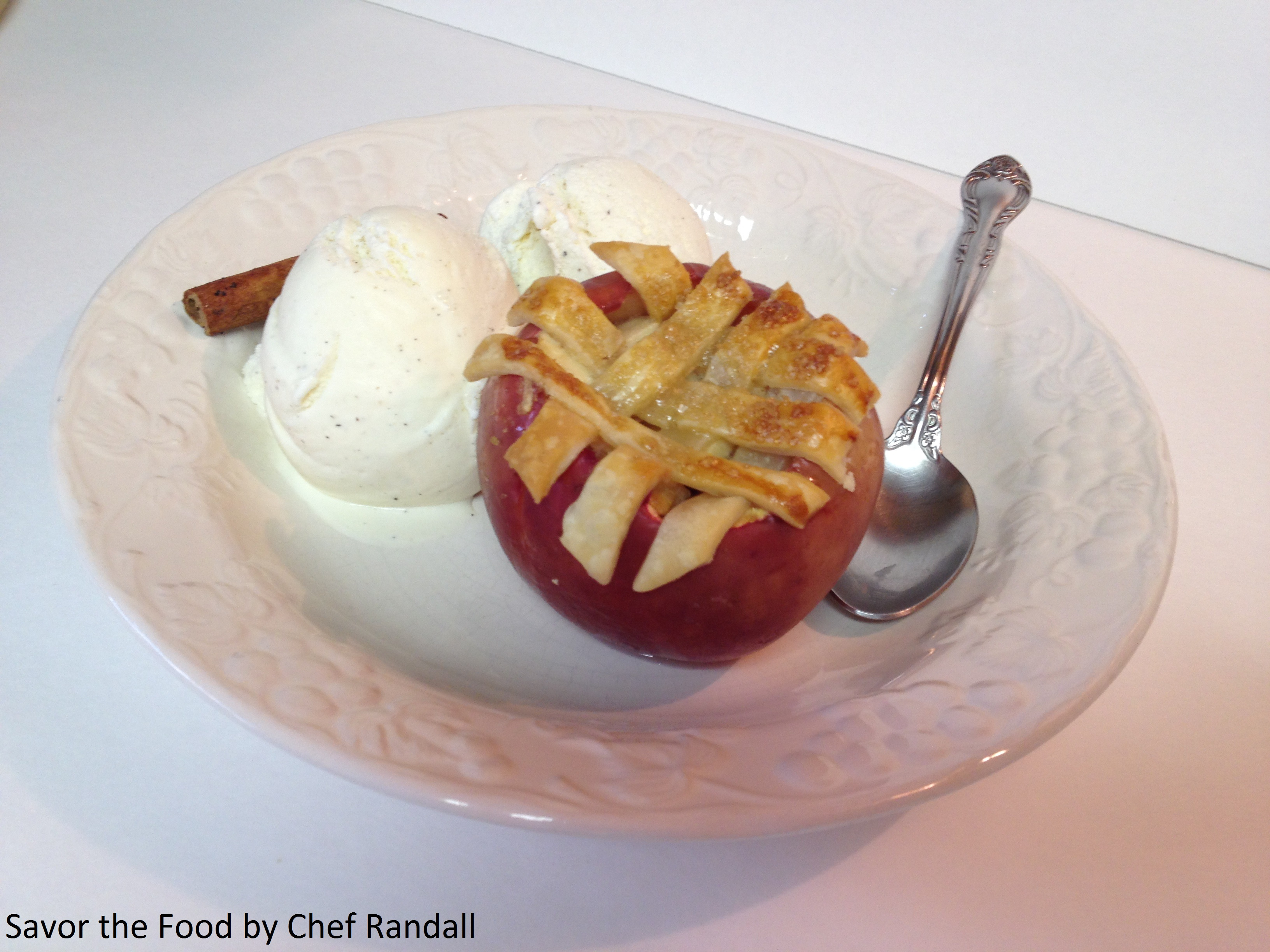 A Baked Apple Apple Pie with a side of real vanilla ice cream