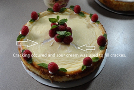 fill cracks on a cheesecake with sour cream