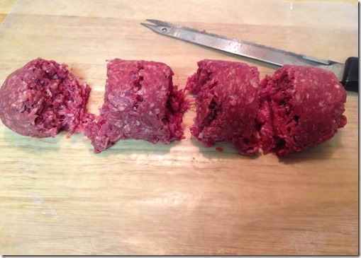 cutting equal parts of hamburger meat