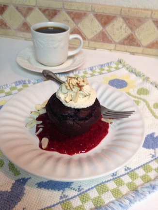 Double Chocolate Cupcakes over Raspberry Sauce Topped with Almond Mocha Whipped Cream with Coffee