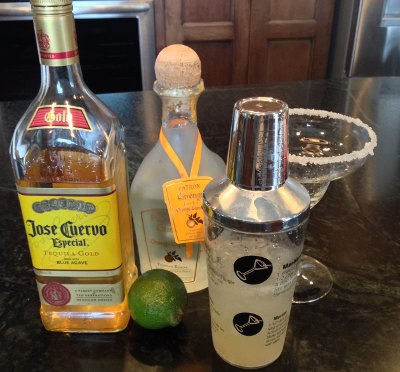 cocktail shaker full of ice and add the tequila, orange liqueur and lime juice
