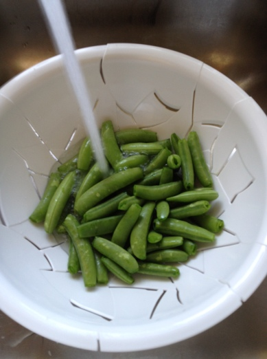 washing snap peas