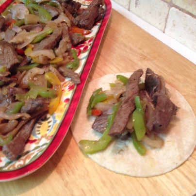 Beef Steak Fajitas focusing on beef and corn tortilla