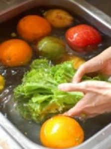 Cleaning Your Produce Naturally washing in a sink of water solution