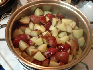 steaming red potatoes for Red Potato and Sweet Pepper  Salad