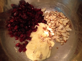 wet and dry ingredients being mixed together for Herb Chicken and Cranberry Almond Salad