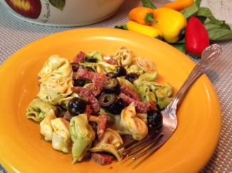 Plated close up of  Tortellini and Summer Sausage with Tomato Basil Vinagrette