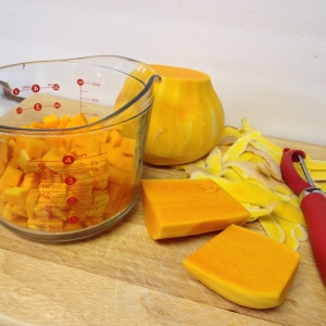 preparing butternut sqaush for Roasted Butternut Squash and Sausage with Gluten Free Penne Pasta