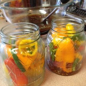 mini sweet peppers in jar waiting for brine