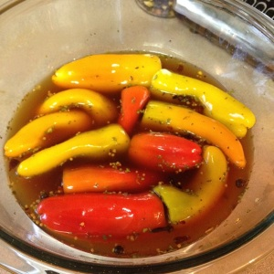 mini sweet peppers marinating in brine