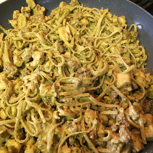Prepared Gluten Free Creamy Pesto Fettuccini in a large ceramic coated  pan