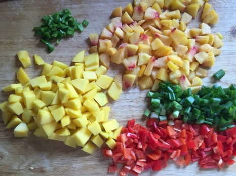 chopped and diced produce for Peach and Mango Salsa
