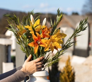 decorating grave site with flowers