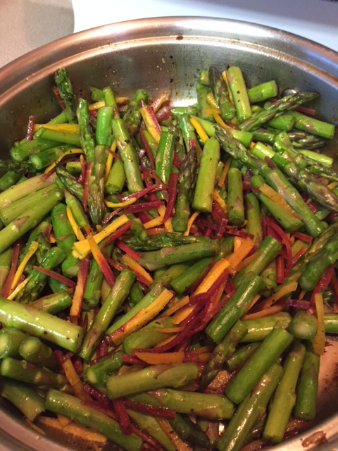 cooking asparagus and carrots in a large skillet