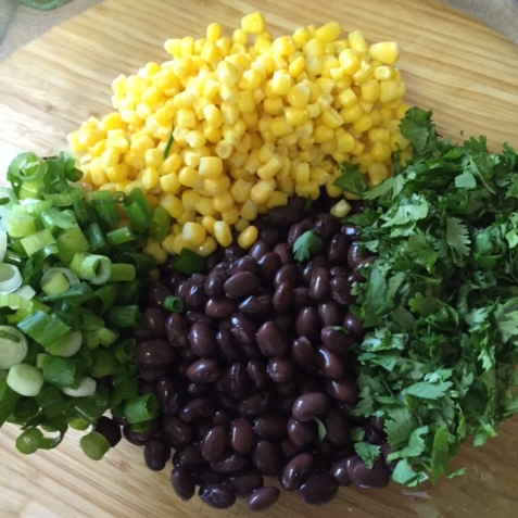 fresh ingredients for Stuffed Sweet Potato with Chipotle Black Bean and Corn Salad