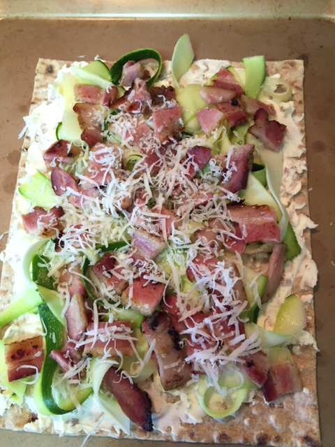 prepared uncooked Flatbread with Zucchini Smoked Bacon and Mascarpone Cheese