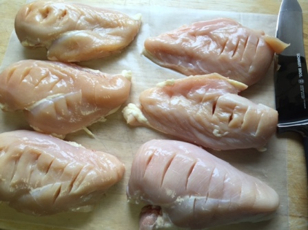 slits cut into chicken breasts