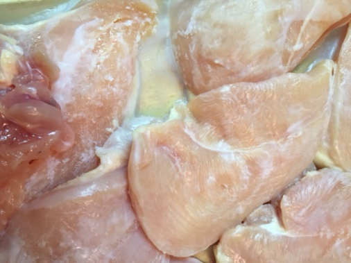 chicken breasts coated with coconut oil