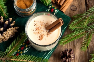Eggnog with nutmeg and a cinnamon stick