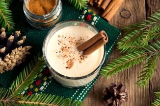 Eggnog with nutmeg and a cinnamon stick