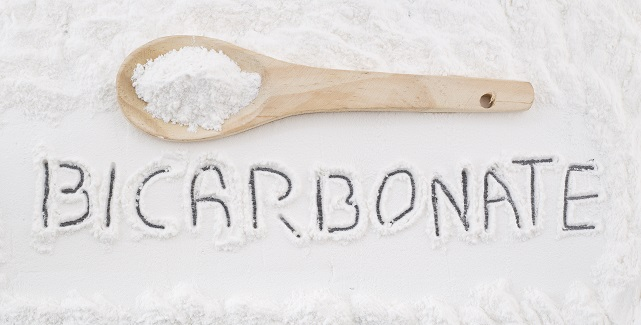 Bicarbonate of Soda with a wooden spoon
