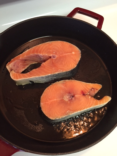 Salmon steaks in a cast iron skillet