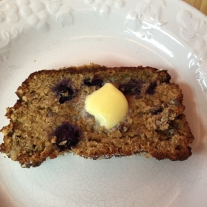 Slice of Gluten Free  Blueberry Lemon Bread topped with Organic Butter