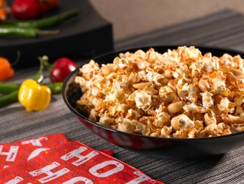 bowl of fresh made Adobo and Roasted Peanut Popcorn on a table