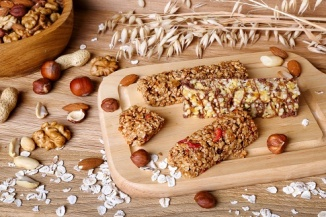 Granola Bars with oats and nuts on the table