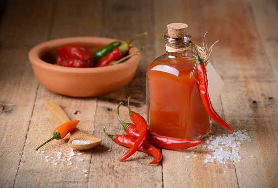 tabasco sauce homemade in small glass bottle - National Hot Sauce Day