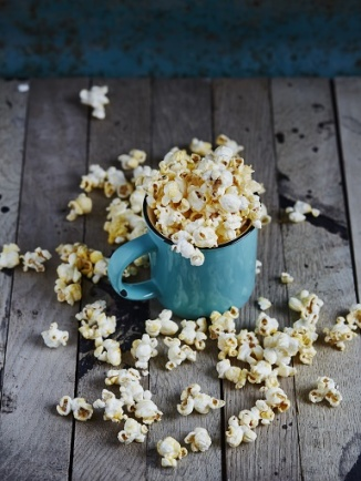 Mint cup full of popcorn -  National Popcorn Day 2016