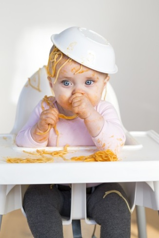 National Spaghetti Day - Little Girl Eating her spagheti dinner and making a mess