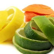 lemon, orange, lime peels on a white surface - citrus peel to remove odors