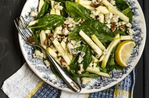 salad plate with Warm Winter Salad with Apples Spinach Blue Cheese and Walnuts