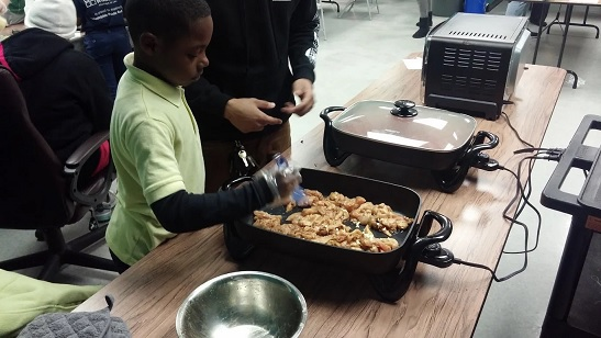 young boy in a cooking class