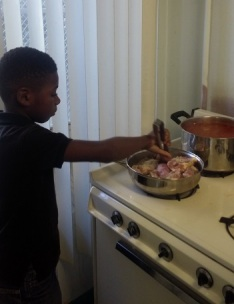 young boy learning to cook - Cooking Simple With Your Family