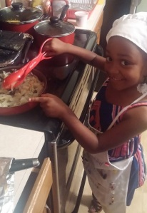 young girl cooking - - Cooking Simple With Your Family