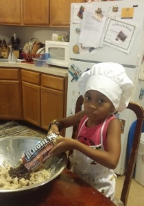 young girl helping to make cookies - Cooking Simple With Your Family