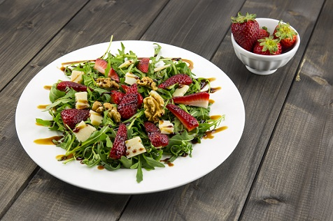Arugula Salad Topped with Walnuts Strawberries and Parmesan Cheese