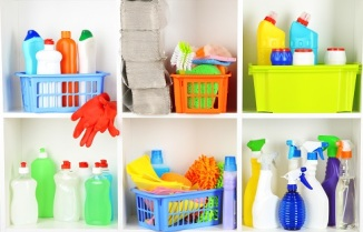 Shelves in pantry with cleaners for home close-up - household cleaners
