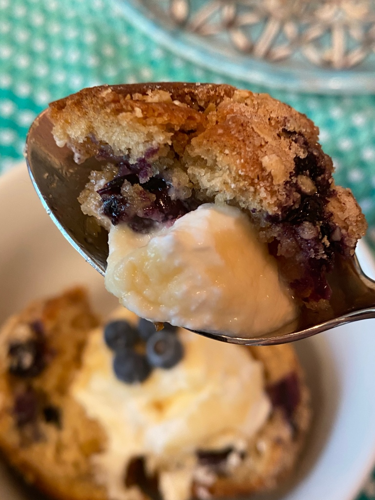 Spoon with  blueberry  muffin and yogurt